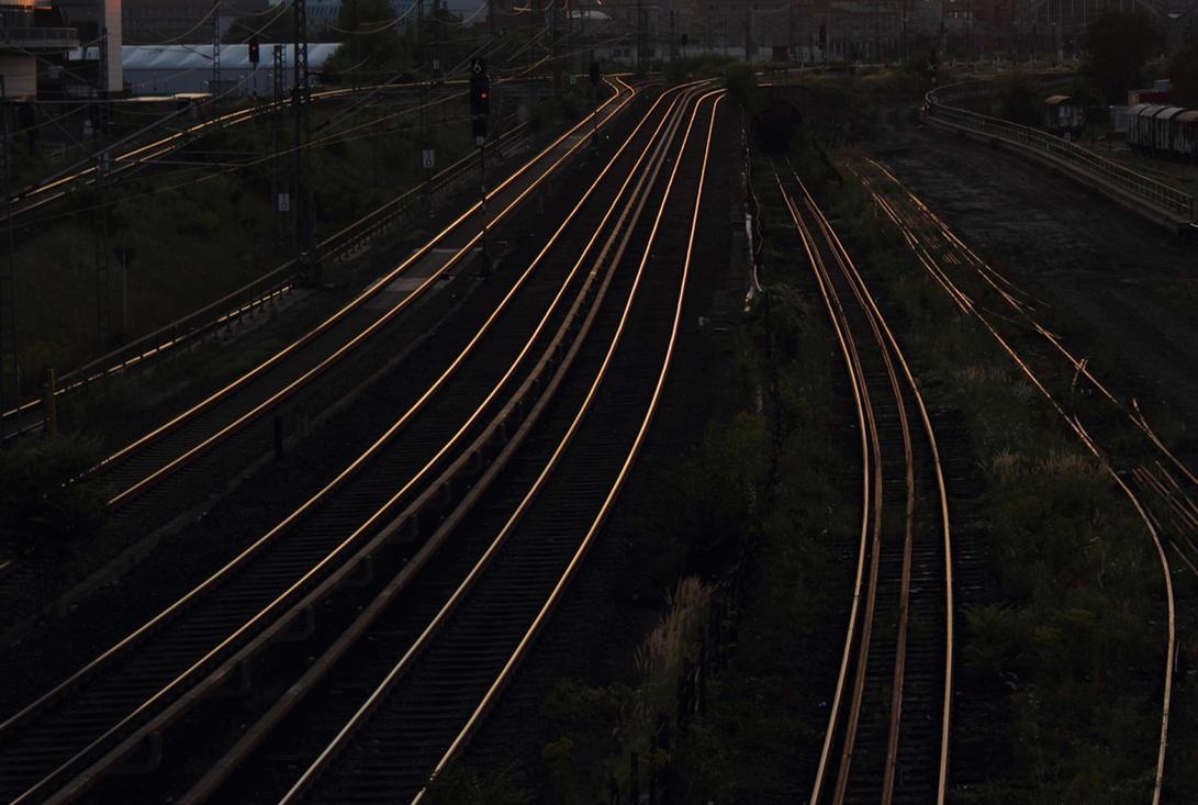 Rail tracks in the rising sun by LoByteSo