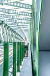 Boy standing in bridge construction