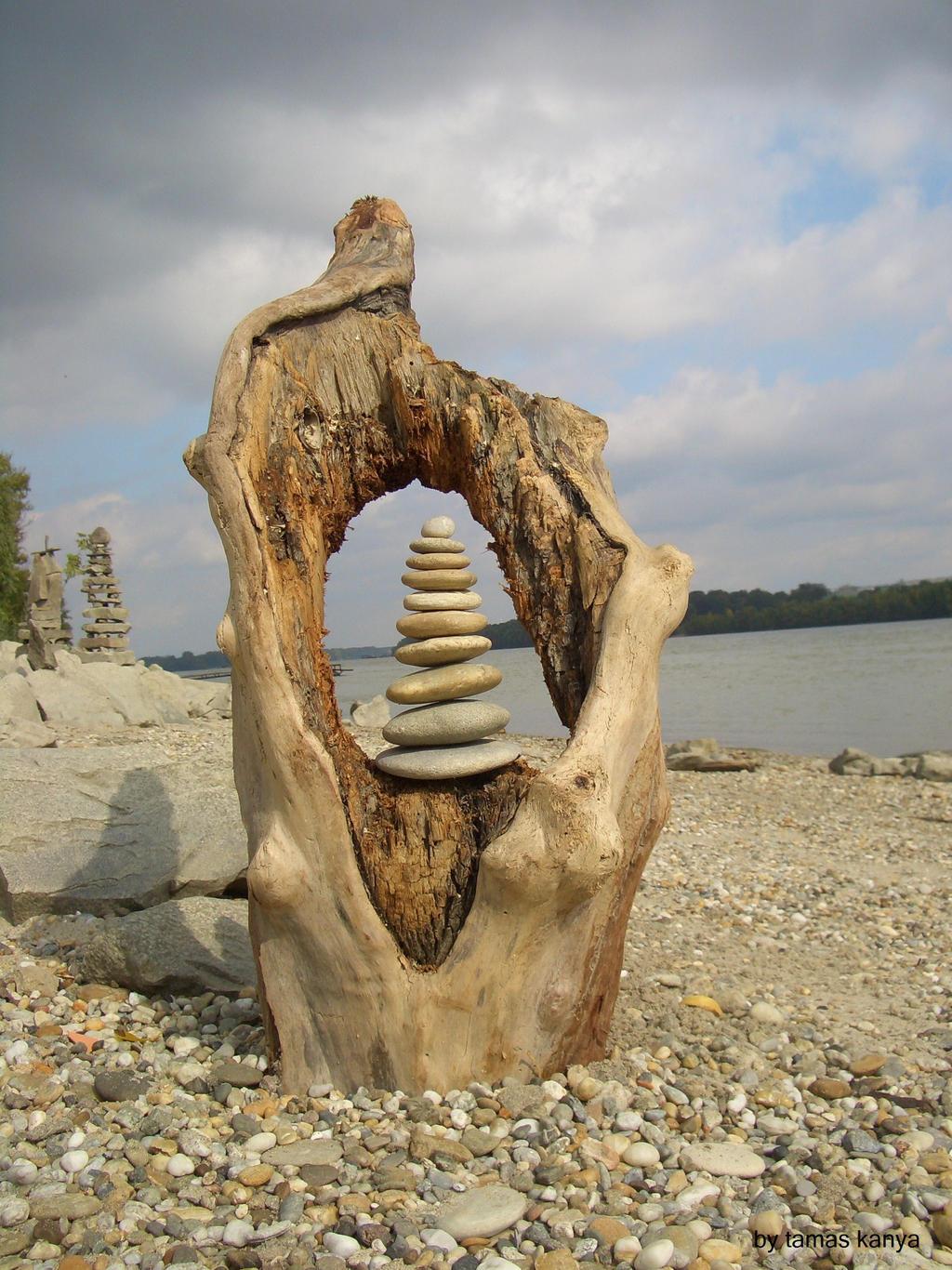 Driftwood art stone balance by tamas kanya tom