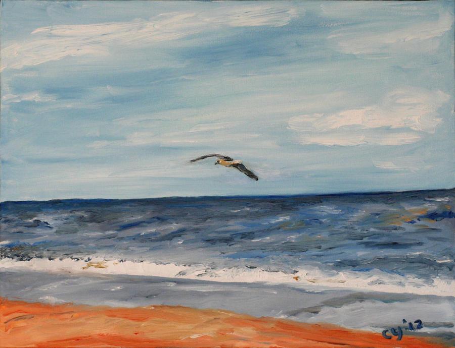 Bird over Beach by CarolynYM
