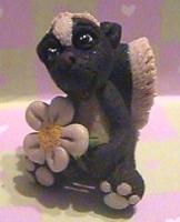 polymer clay skunk flower by crazylittlecritters