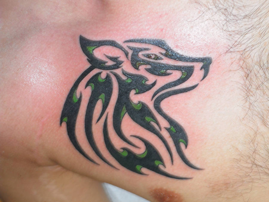 Tribal wolf tattoo - green by ean5533