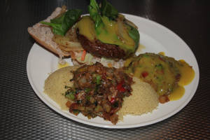 Hamburger and couscous with curry-sauce wok