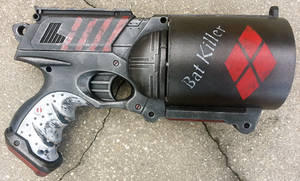 Custom Harley Quinn Batkiller pistol prop by firebladecomics