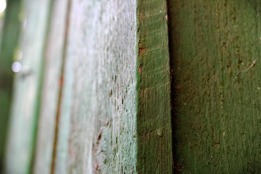 Green wooden plank