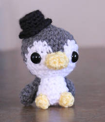Tiny penguin with hat