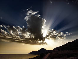 beams and clouds in Crete by VaggelisFragiadakis