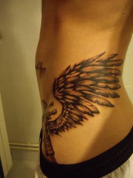 winged paint gun spray tattoo