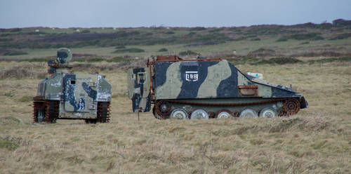 2 Wrecked Armoured Personnel Carriers..