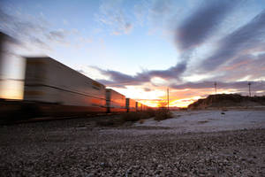 Racing Trains in the Desert in Arizona at sunset by bluedogsd