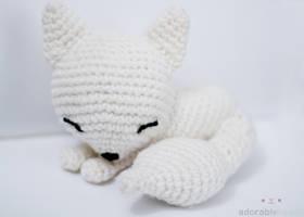 sleepy white fox