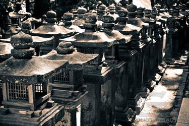 Stone lanterns in Nara by NanoRoux