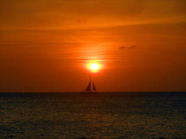 Sailing In An Aruban Sunset by discoinferno84