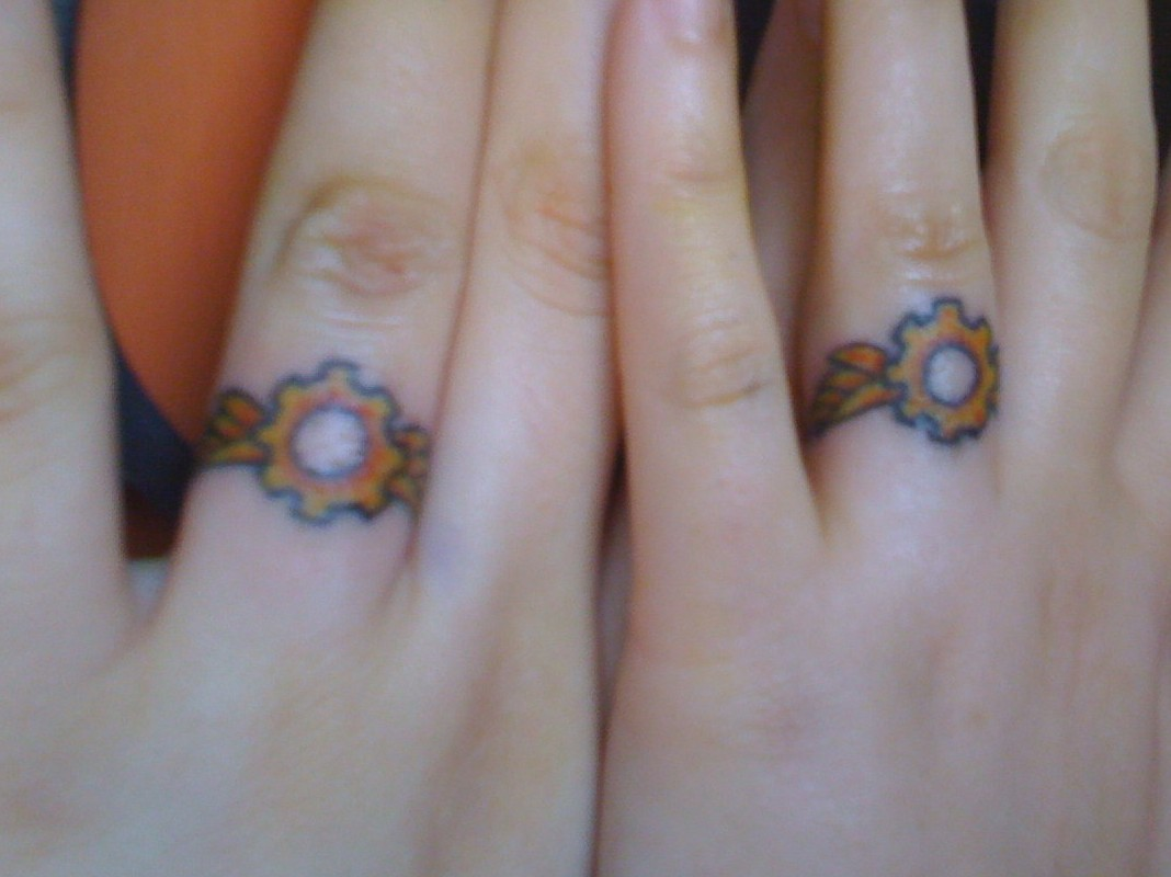 55 romantic wedding ring finger tattoo designs and ideas - Photo Source