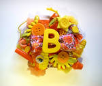 orange and yellow ''B'' initial brooch
