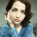 Girl revealing her Emily Rudd disguise