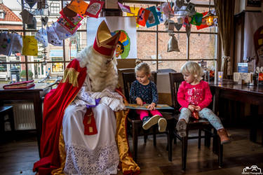 Child Reading Book With Sinterklaas by SIG442