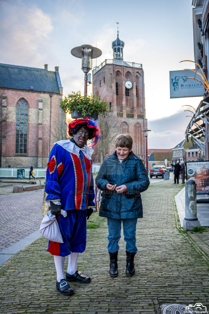 Zwarte Piet Gives Some Candy to A Elderly Woman by SIG442