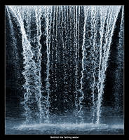 Behind the falling water by ssilence