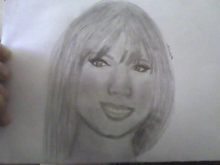 Mi dibujo de Taylor xD by Ifeelbeautiful