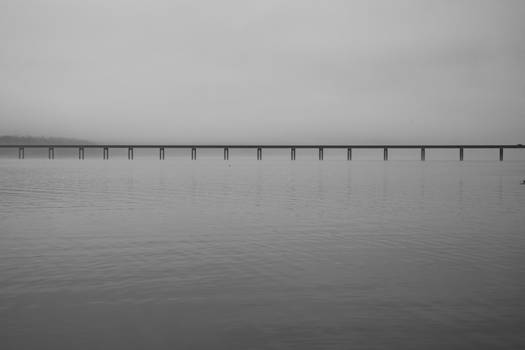 Bridge over foggy reflection