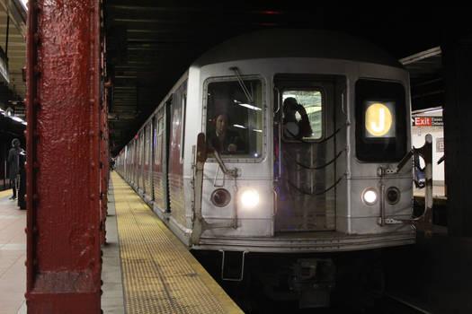 R42 (J) train at Essex Street