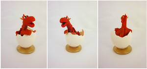 Red dragon in egg