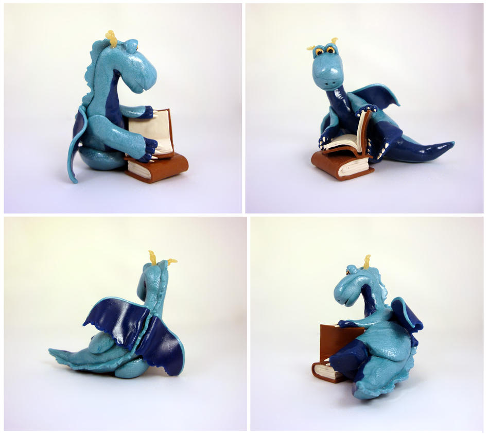 Blue dragon with a book by Koreena