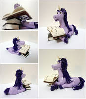 Purple unicorn with books by Koreena