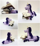 Purple unicorn with books