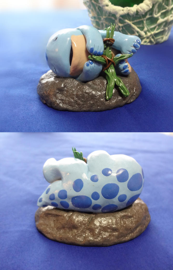 Sleeping baby quaggan figurine