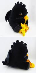 Sleepy yellow eyed black dragon by Koreena