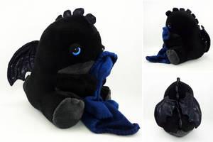 Sleepy blue eyed black dragon by Koreena