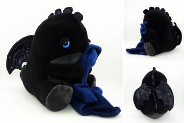 Sleepy blue eyed black dragon