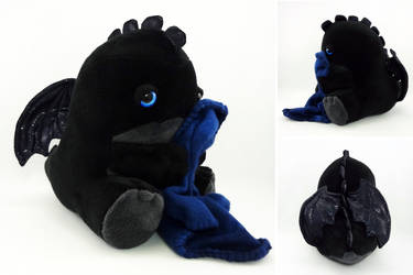 Sleepy blue eyed black dragon