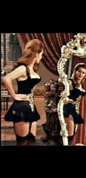 Annabella admires her figure