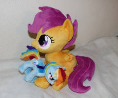 Scootaloo with her very own Rainbow Dash plush! by Epicrainbowcrafts