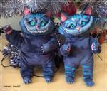 Cheshire cats by rill-rain