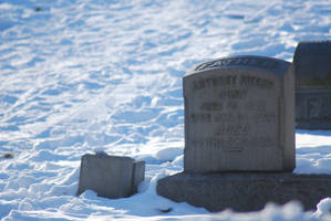 Tombstone in the snow by danhauk