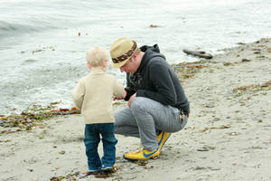 Father and Son on Beach by IQuitCountingStock