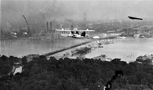 Plane flying over Belle Isle (1915)