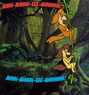 Sasha and Bess swing on a vine in the jungle