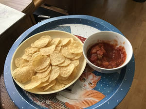 a photo of nachos and salsa.