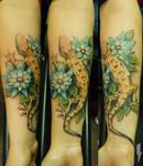 tattoo lizard in the flowers