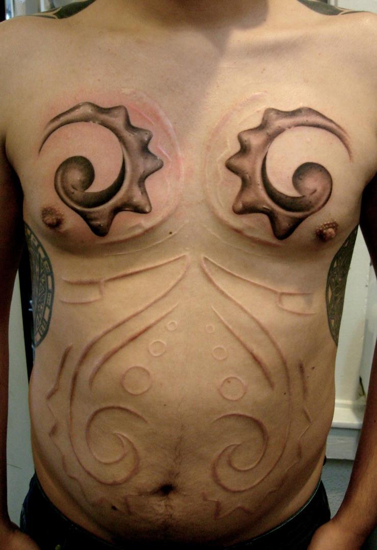 caracol_scar_and_tattoo_by_tattoosbygoethe.jpg