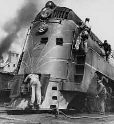Soldiers working on a locomotive, Chicago, 1945