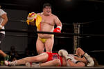 Sumo strips to G string and taunts his KO gal