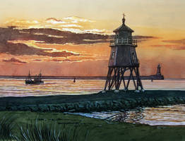 Sun rising over Groyne lighthouse, South Shields.
