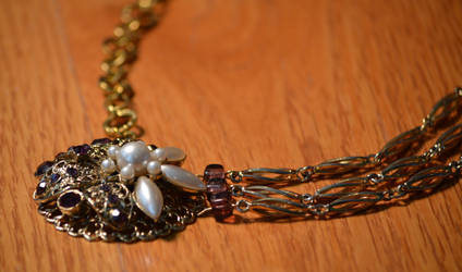 Gold Necklace with Purple Brooche
