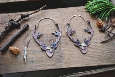Deer silhouette Earrings by twistedjewelry